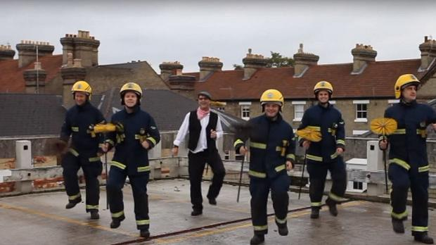 Firefighters recreate a scene from Mary Poppins to encourage residents to get their chimneys swept (Cambridgeshire Fire and Rescue Service/PA)