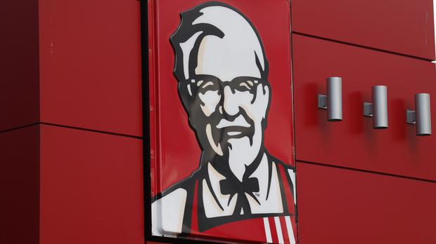 KFC said it will start delivering its buckets of fried chicken to customers in Los Angeles and San Francisco (AP)