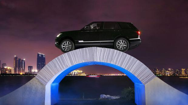 The Range Rover SUV being driven across a bridge made of paper in Suzhou, China (Land Rover /PA)