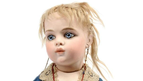 A Bru antique 135-year-old French doll with striking blue eyes named Helene Alicia which has been sold for £17,000 at auction (Vectis/PA).
