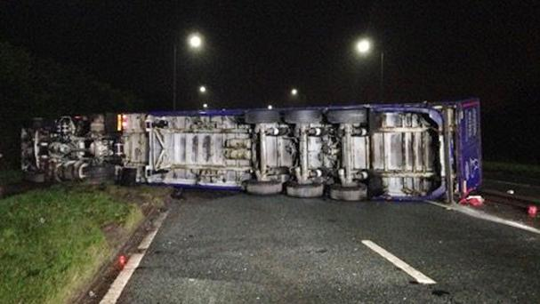 Photo taken from the Twitter feed of @gmptraffic of the scene after a HGV carrying ketchup overturned on the A580 in Manchester (@gmptraffic/PA)