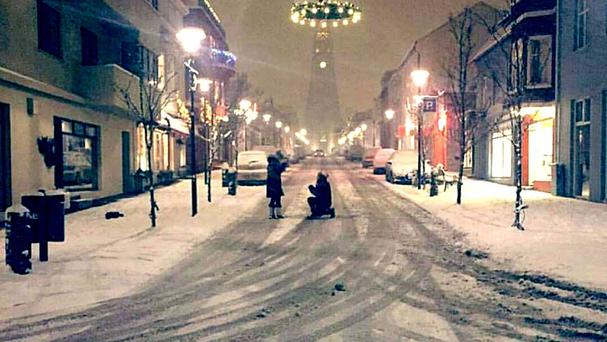 Jessica Bowe captured Michael Kent's proposal to girlfriend Fiona Newlands in Reykjavik, Iceland, as the couple have been reunited with the photo after appealing on social media
