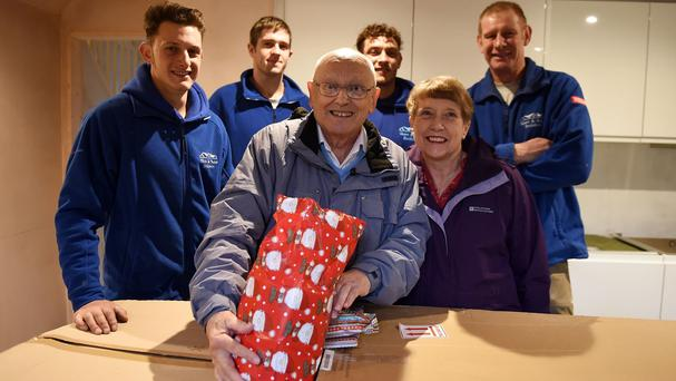 David Haylock and his wife Carol are given presents by builders who found a 60-year-old note he wrote to Father Christmas