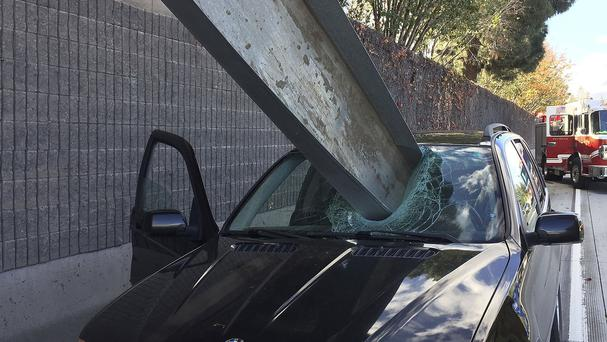 Don Lee cheated death by a whisker when a massive beam crashed through his SUV's windscreen (San Jose Fire Department/AP)