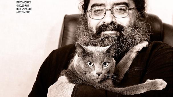 Russian monk Feodorit holds his cat Monya in an undisclosed location in Russia (Anna Galperina/Artos via AP)