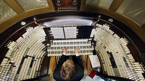 Steven Ball, staff organist with the Historic Organ Restoration Committee, at the console of the huge Boardwalk Hall attraction (AP)