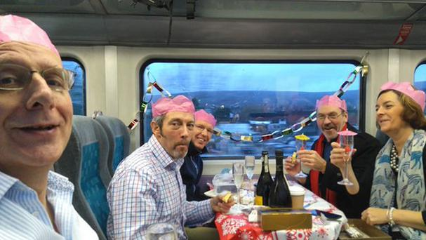 Chris Lines and friends celebrating Christmas together on their daily train ride to work (Chris Lines /PA)
