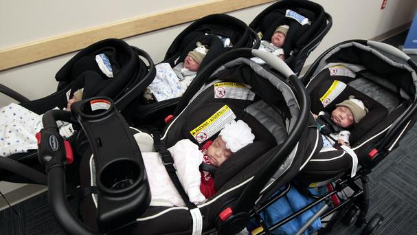 The Dela Cruz quintuplets wait in their prams to go home together for the first time at Kapiolani Medical Centre in Honolulu (AP)