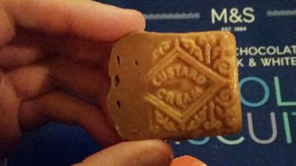 The biscuit found by Peter Marshall of a biscuit he found in a box of Marks and Spencer's Extremely Chocolatey biscuits. (Instagram / PA Wire)