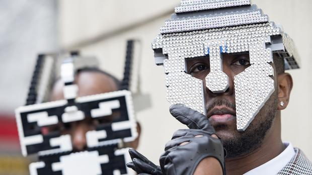 Paul, left, and Peter Allimandi of Bwoywonder wearing their self-made Lego masks