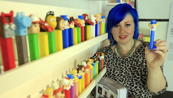 Kelle Blyth, from Norfolk, stands amongst her 3,000-strong collection of Pez dispensers