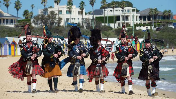 Pipers take a break on Brighton beach in Melbourne, Australia, before a rare overseas performance of the Royal Edinburgh Military Tattoo (Rob McDougall/Royal Edinburgh Military Tattoo/PA)