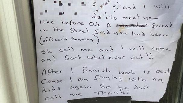 A note, partially obscured, that officers found taped to a door from a conscientious thief (West Midlands Police/PA)