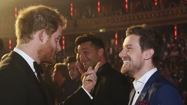 Comedian Chris Ramsey with Prince Harry after a Royal Variety Performance