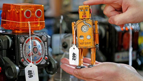 Andy Reed, die cast specialist at Vectis Auctions holds Robot Liliput from Japan, a wind up robot from 1939