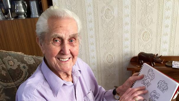 103-year-old Jack Reynolds, from Derbyshire, who is planning to have a tattoo done for his 104th birthday looks through potential designs