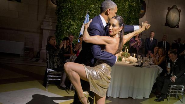 President Obama tangos with a dancer during the state dinner in Buenos Aires (AP)
