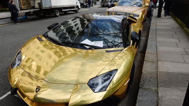 Gold cars which have received parking tickets on Cadogan Place in Knightsbridge, London