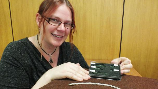 Archaeologist Emily Gillott with the remains of a metal scourge discovered at Rufford Abbey, Nottinghamshire, alongside a recreation of what the device probably looked like in the 14th Century