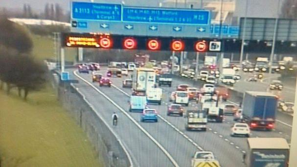 A cyclist was fined after being caught riding his bike on the M25 (RPU - Surrey Police/PA)