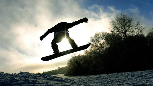 The footage shows a bear appearing to chase the snowboard