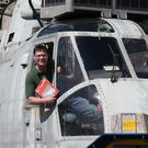 Stirling farmer Martyn Steedman sits in the cockpit of the Sea King helicopter after it arrived in Thornhill to start life as holiday accommodation