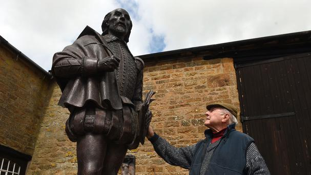Sculptor James Butler with his statue of William Shakespeare