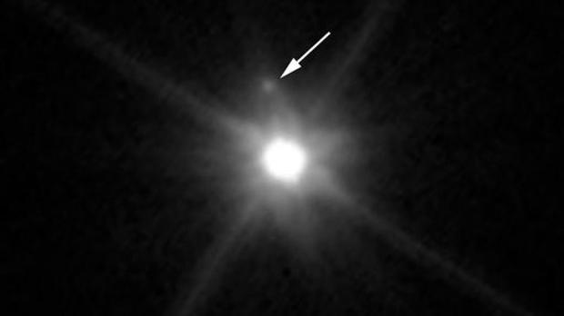 A small, dark moon orbiting Makemake, the second brightest icy dwarf planet in the Kuiper Belt (Nasa via AP)