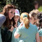 The Duchess of Cambridge meets children at Hampton Court's recently unveiled Magic Garden
