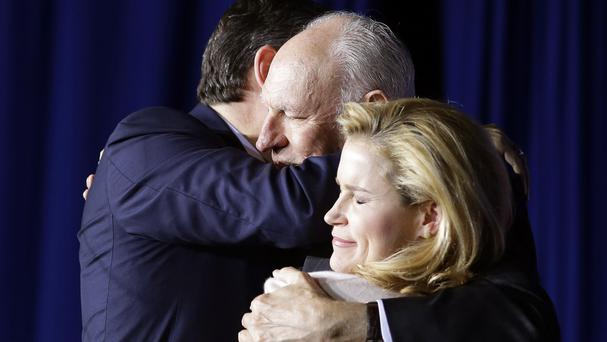 Ted Cruz hugs his father Rafael and wife Heidi (AP)