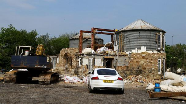 A view of the home of cattle farmer Robert Fidler in Salfords, near Redhill in Surrey, as the process of demolishing the property continues after he lost a ten year court battle