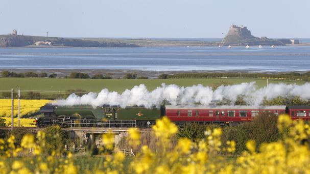 The Flying Scotsman passes the Holy Island, Berwick-upon-Tweed