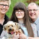 Sandra and Peter Wright and daughter Emma, with their Yorkshire terrier Eddie, who was missing for five years (PDSA)