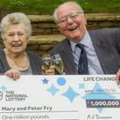 Mary and Peter Fry celebrate their family's Lotto Millionaire Raffle (PA/National Lottery)
