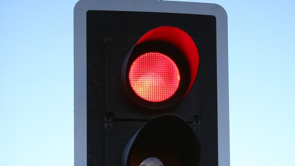An American boy reported his father for driving through a red traffic light