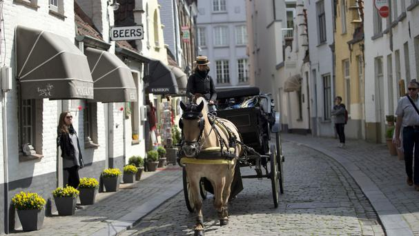 Brewery lorries negotiating Bruges' historic narrow streets will be a thing of the past when the underground pipeline ships beer straight to the bottling plant (AP)