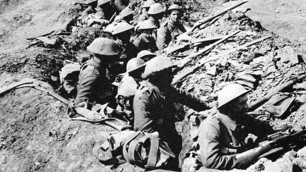 British soldiers occupy a trench in a ruined landscape before an advance during the Battle of the Somme