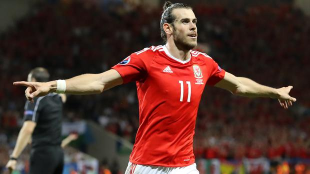 Gareth Bale celebrates scoring his side's third goal during the Uefa Euro 2016 Group B match in Toulouse