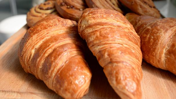 A plan to give out free croissants has been banned by the elections watchdog