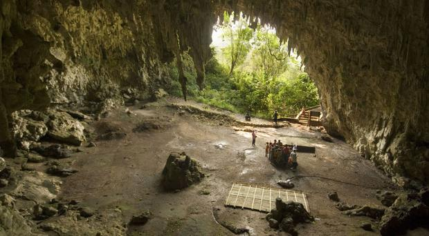 """The Liang Bua cave on the Indonesian island of Flores, where scientists have found evidence of both """"hobbit"""" and modern human occupation (University of Wollongong)"""