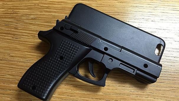 A gun-shaped iPhone case which a passenger carried through security at Stansted Airport (Essex Police/PA)