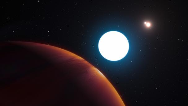 An artist's impression showing a view of the triple star system HD 131399 (ESO/PA)