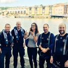 Police divers with Nicola Hazell after they found her engagement ring while on a training exercise in Bristol docks (PS Nick Owen/Avon and Somerset Police/PA)