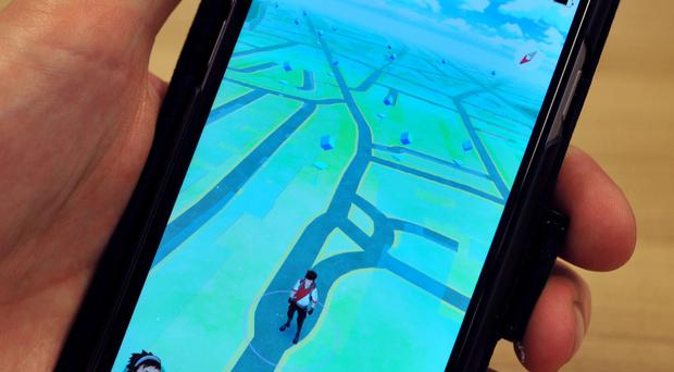 Players travel around the real world, using their phones to capture and train creatures known as Pokemon