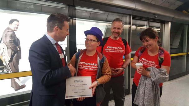 Alasdair Clift accompanied by his mother Caroline and father Richard, is presented a certificate at Southwark Underground station during his attempt to visit all 270 Underground stations in one day
