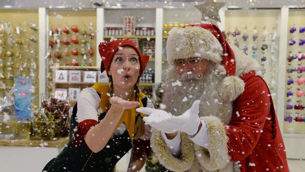 Father Christmas is on hand at the opening of Selfridges' Christmas shop at its department store in Oxford Street, London