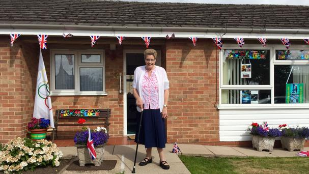 Mavis Williams, the grandmother of Adam Peaty, stands outside her home in Uttoxeter