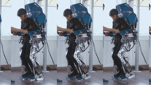 A patient using a brain-controlled robotic exoskeleton (Nature/PA)