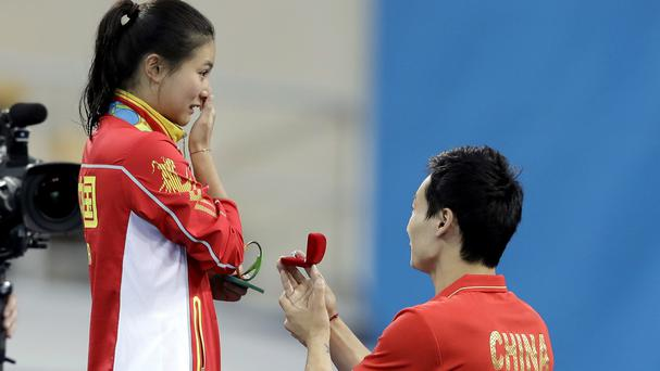 China's diving silver medalist He Zi receivers a marriage proposal from team mate Qin Ki (AP)