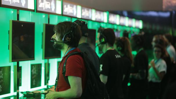 Visitors play computer games at Gamescom in Cologne, Germany (AP)